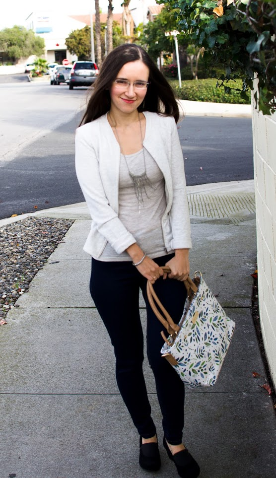 Oksancia holding Hessa bags olive branch peace handbag with her repeating pattern design